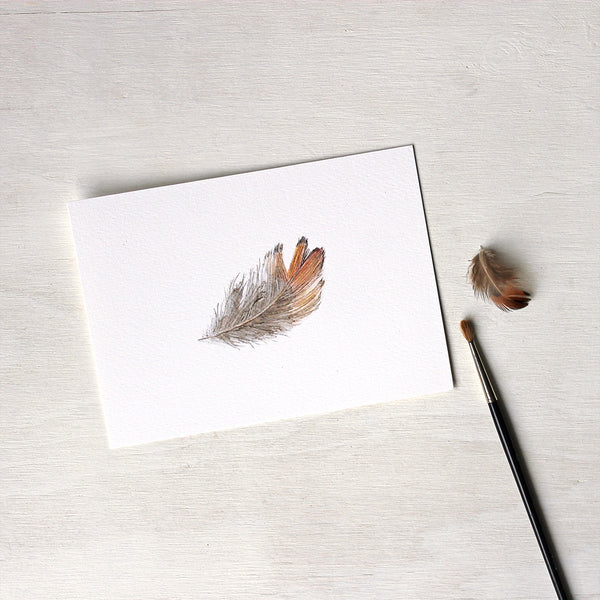 Print of an orange and brown pheasant feather watercolour painting by Kathleen Maunder.