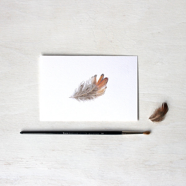Print of a delicate brown and orange pheasant feather watercolor painting by Kathleen Maunder.