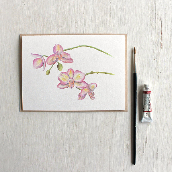 Note card featuring watercolor painting of pink and yellow orchids. Artist Kathleen Maunder.