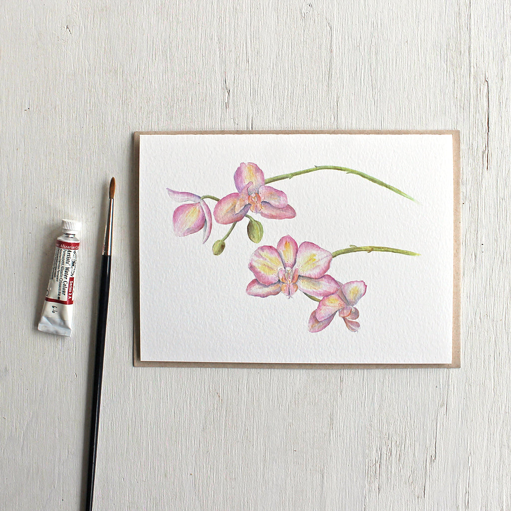 Note card with watercolour painting of pink and yellow orchids.