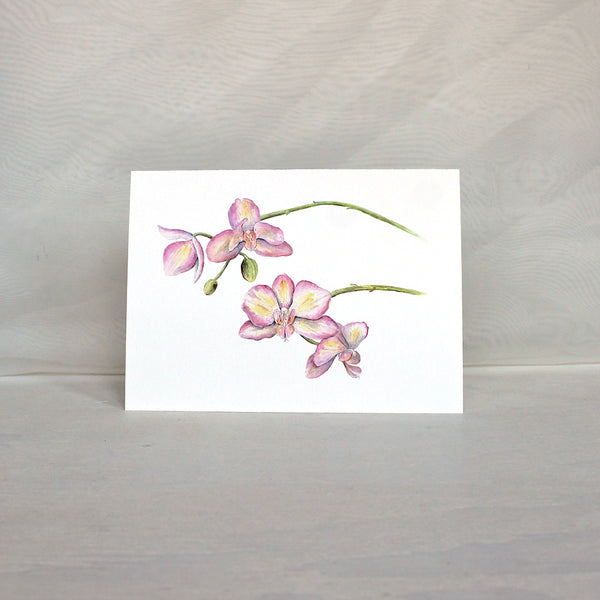 Note card featuring a watercolor painting of pink and yellow orchids.