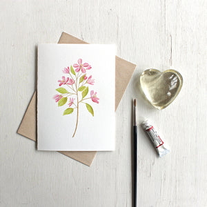Note card featuring watercolor painting of pink crabapple blossoms. Artist Kathleen Maunder.