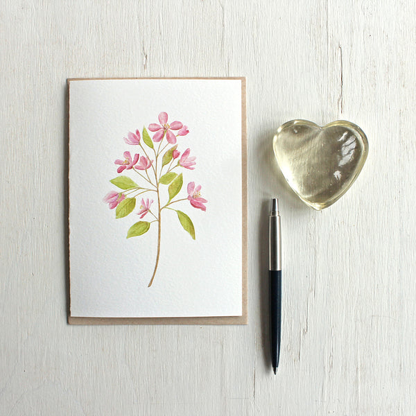 Note card with a pink crabapple branch painted in watercolor. Artist Kathleen Maunder