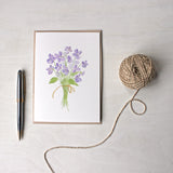 Note card featuring a watercolor painting of violets by Kathleen Maunder
