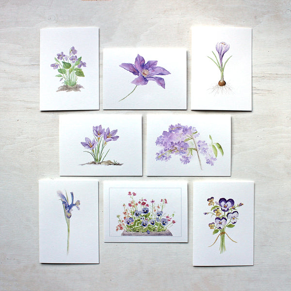 Set of eight note cards featuring purple flowers. Painted in watercolor by Kathleen Maunder.