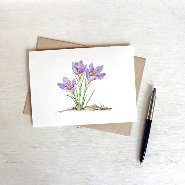 Three purple crocuses featured on watercolor note card