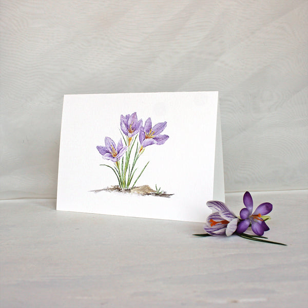 Note card featuring watercolor painting of three purple crocuses