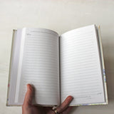 Inside pages of hardcover journal with Bible quotes.
