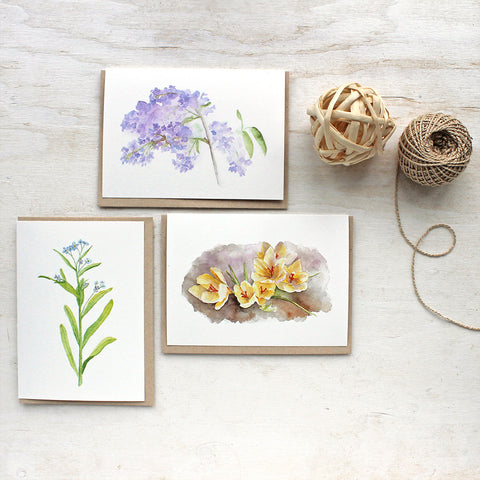 Spring flower watercolor cards by Kathleen Maunder of Trowel and Paintbrush. Featuring lilacs, crocuses and forget-me-nots.