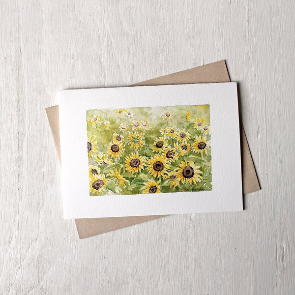 Watercolor note card featuring a sunflower field. Painting by Kathleen Maunder.