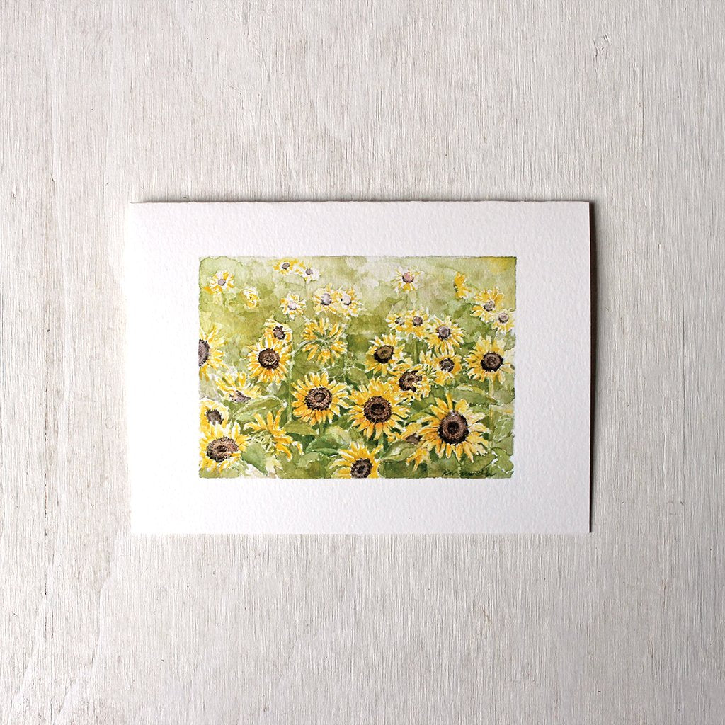 Note card featuring a watercolor painting of a sunflower field by Kathleen Maunder