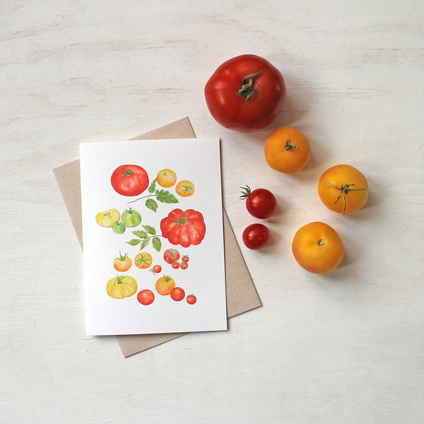 A note card showing several kinds of red, yellow and green heirloom tomatoes by watercolor artist Kathleen Maunder.