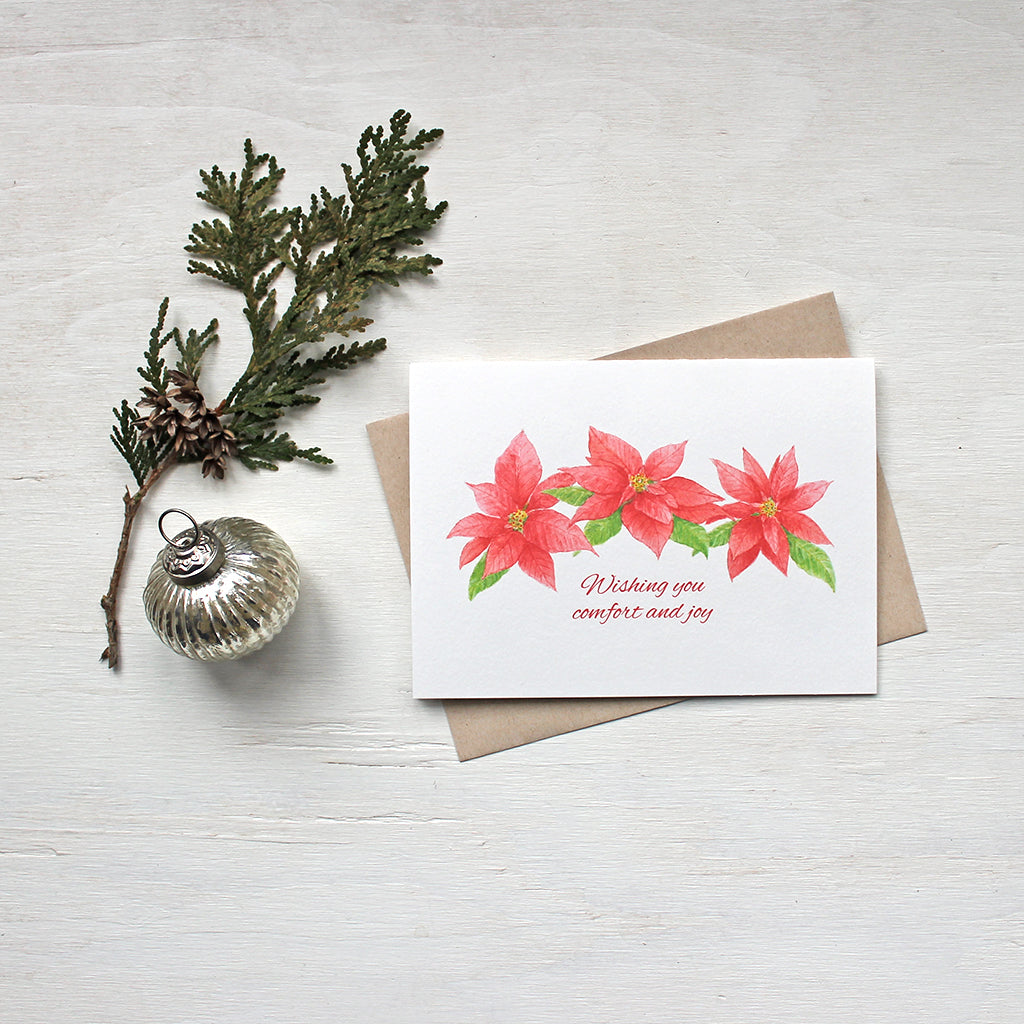 Holiday cards featuring three red poinsettias painted in watercolor by artist Kathleen Maunder