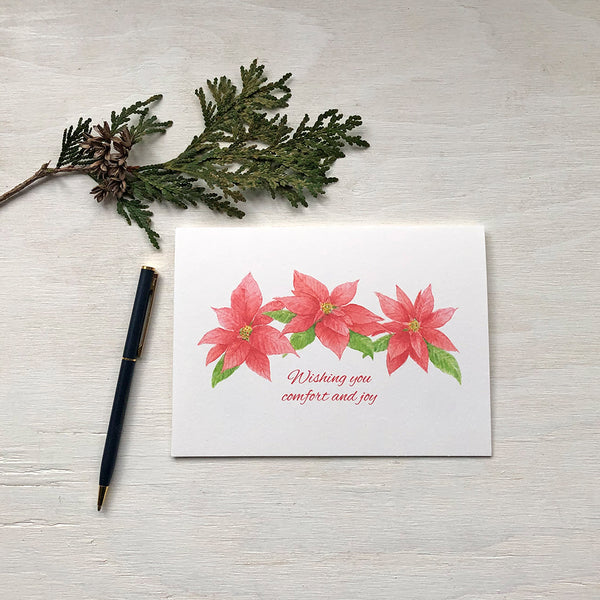 Red poinsettia Christmas card painted in watercolour by artist Kathleen Maunder