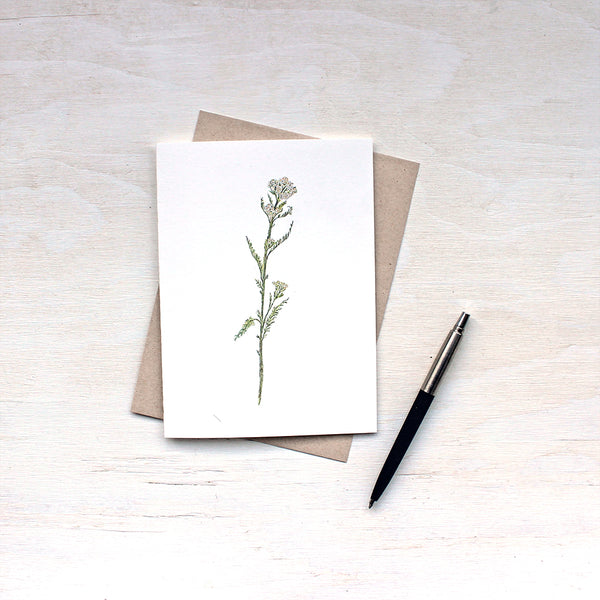 White yarrow note card and recycled kraft envelope featuring a watercolor by Kathleen Maunder