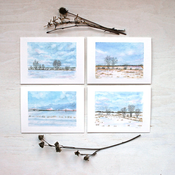 Note card assortment featuring four different winter landscape paintings by watercolour artist Kathleen Maunder.
