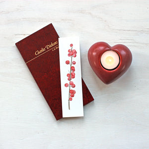 Paper bookmark featuring a watercolor of winterberry by Kathleen Maunder