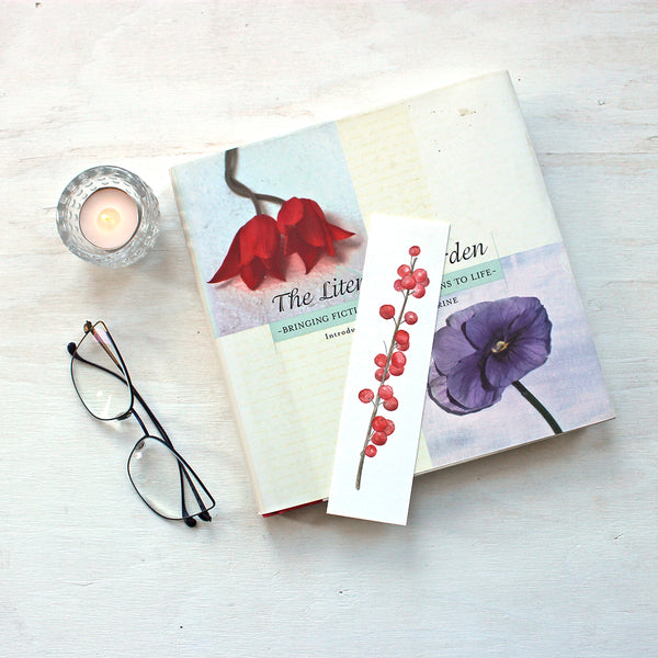 Bookmark featuring a watercolour painting of winterberry by artist Kathleen Maunder