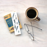 Bookmark featuring a watercolor painting of woodpecker feathers by artist Kathleen Maunder