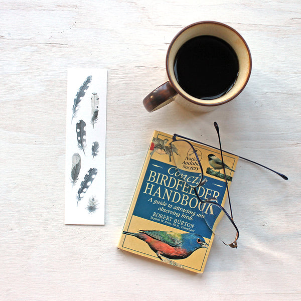 Bookmark featuring a painting of woodpecker feathers by watercolor artist Kathleen Maunder