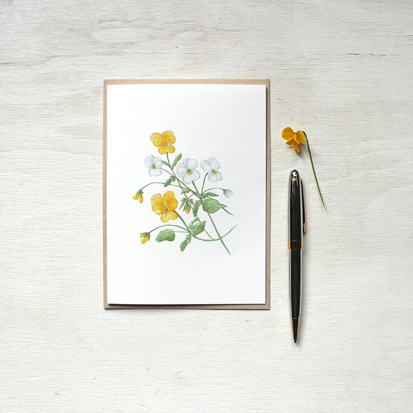 Botanical note card featuring a painting of yellow and white violas by watercolor artist Kathleen Maunder.