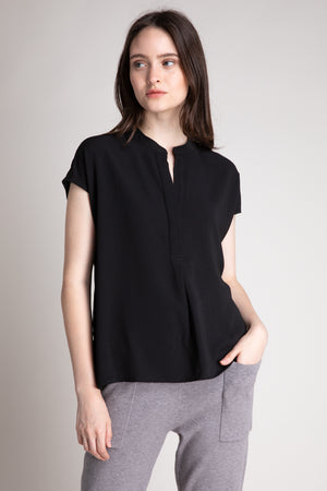 HIDDEN PLACKET SLEEVELESS SHIRT  100% POLYESTER IMPORTED