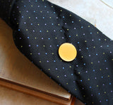 Yellow concrete tie tack