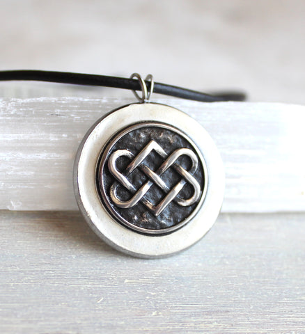 White concrete and stainless steel Celtic knot necklace