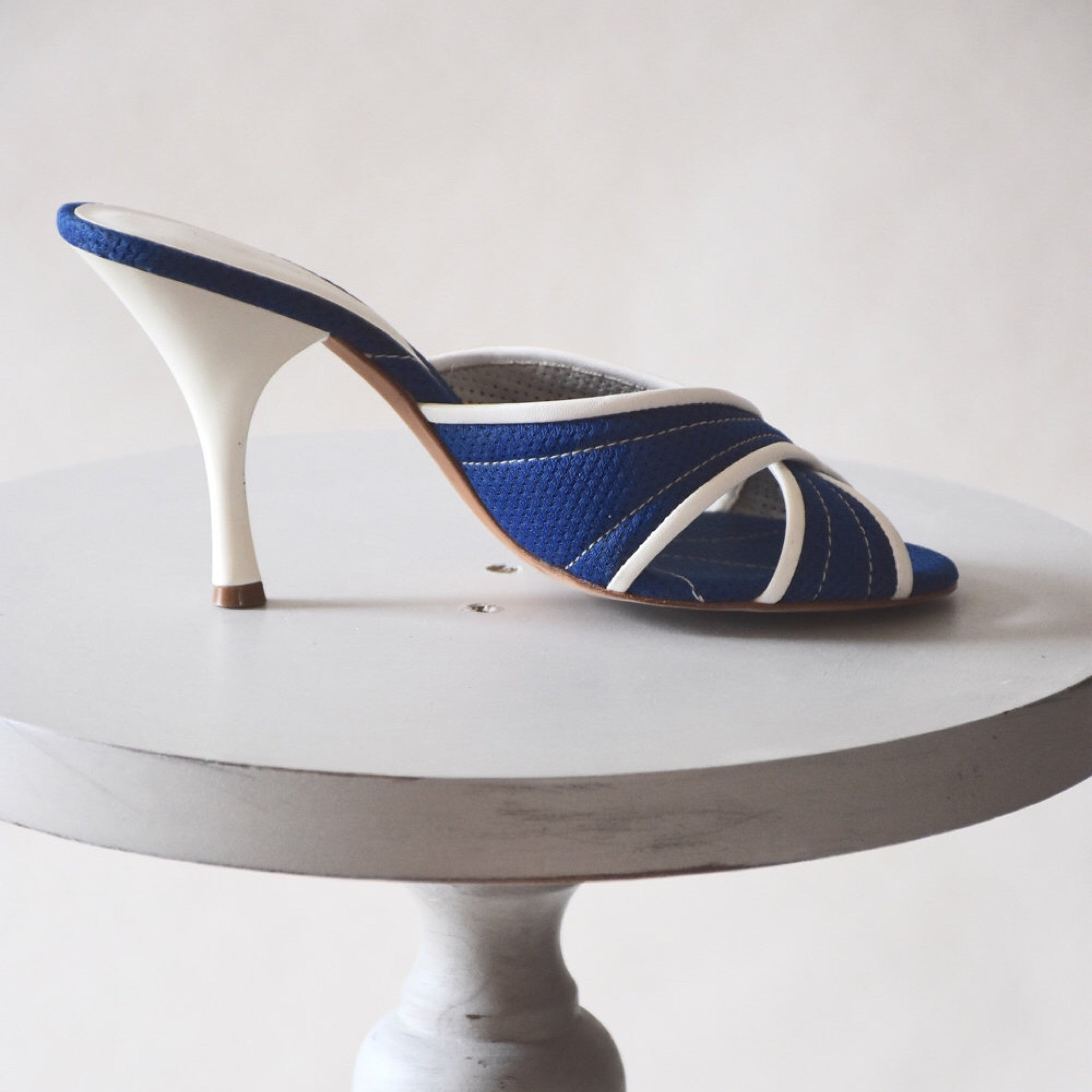 blue and white crossover mules