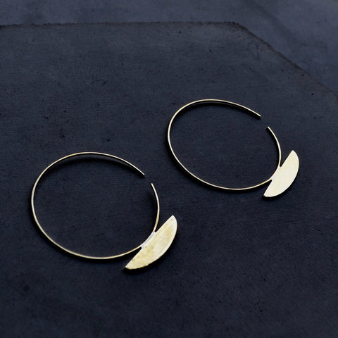 Minimalist large hoop earrings with open ear wire and a half oval shape on the bottom by Material Wit.