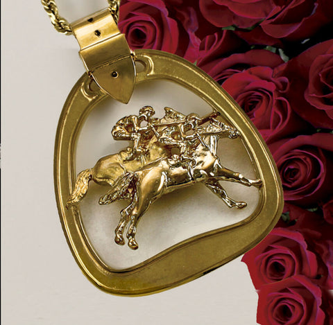 Solid gold horse racing stirrup pendant by Lesley Rand Bennett.
