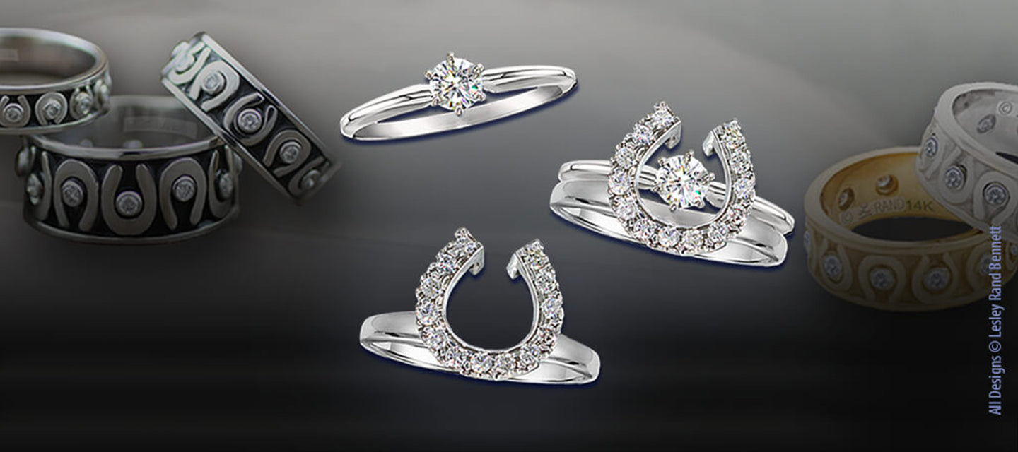 Equestrian wedding rings by Lesley Rand Bennett. Horseshoe wedding rings in gold with diamonds.
