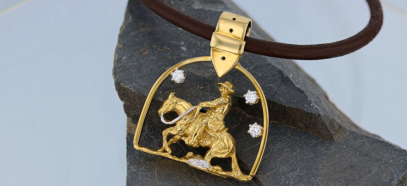 Western reining horse pendant in yellow gold with diamonds by Lesley Rand Bennett