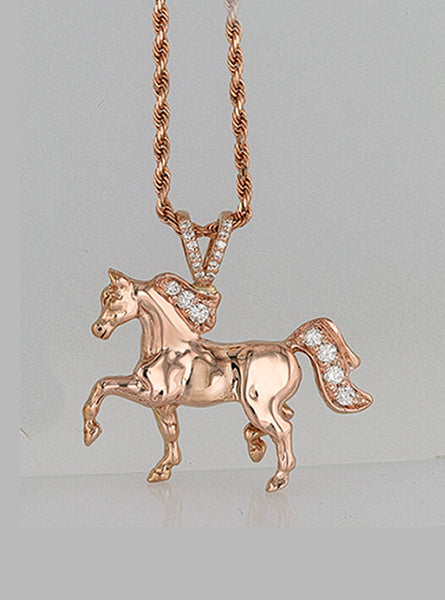 Rose gold trotting horse pendant with diamonds by Lesley Rand Bennett.