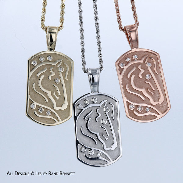 The International Horse Pendant by Lesley Rand Bennett. Pictured in 14k yellow, white and rose gold.