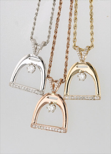 International Stirrup Pendant in 14k gold and diamonds by Lesley Rand Bennett