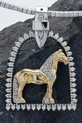 Diamond stirrup horse pendant with Friesian horse in 14k white and yellow gold