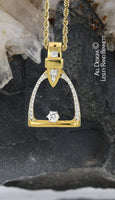 gold and diamond stirrup pendant. this copyrighted design is handcrafted by Lesley Rand Bennett
