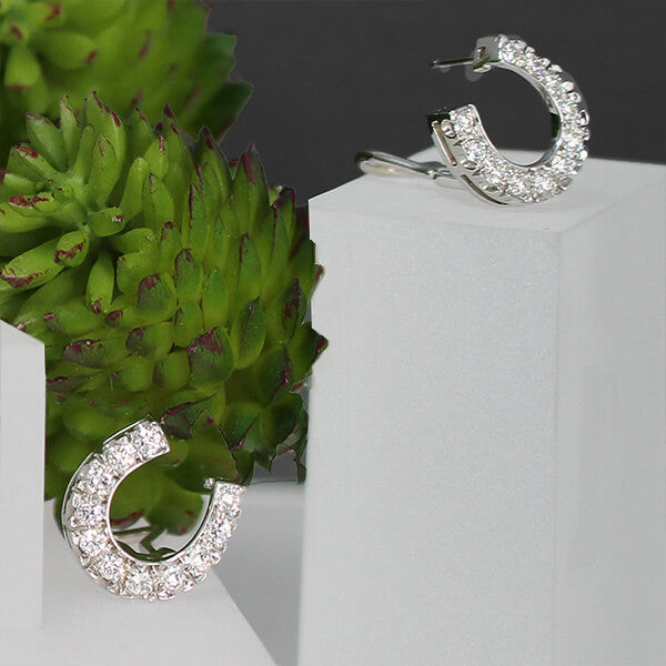 Diamond horse shoe earring handcrafted by Lesley Rand Bennett mid-size1 4k White gold.