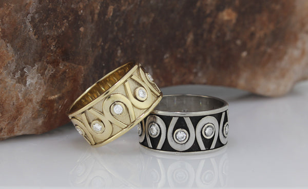 Wide Horseshoe wedding bands with diamonds all around. This copyrighted design is handcrafted in Scottsdale Arizona by Lesley Rand Bennett