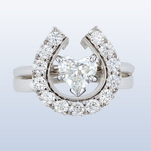 Horseshoe wedding set with Heart diamond solitaire. By Lesley Rand Bennett