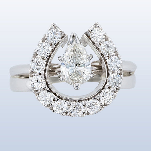 Diamond Horseshoe wedding set with pear shaped diamond solitaire
