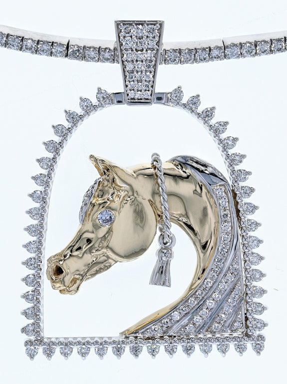 White gold and diamond horse and stirrup pendant by Lesley Rand Bennett. Yellow gold Arabian Horse head with white gold tassel framed by a diamond stirrup and diamond bale.