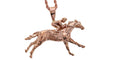 Race horse and jockey pendant in rose gold by Lesley Rand Bennett