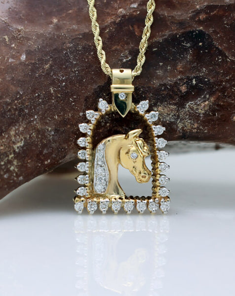 Gold and diamond horse and stirrup pendant copyrighted design is handcrafted by Lesley Rand Bennett