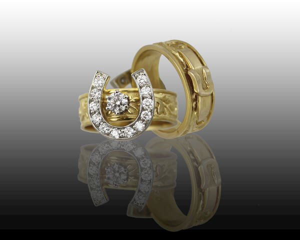 14k and diamond horseshoe ring with western tooling pattern. Handcrafted by Lesley Rand Bennett.