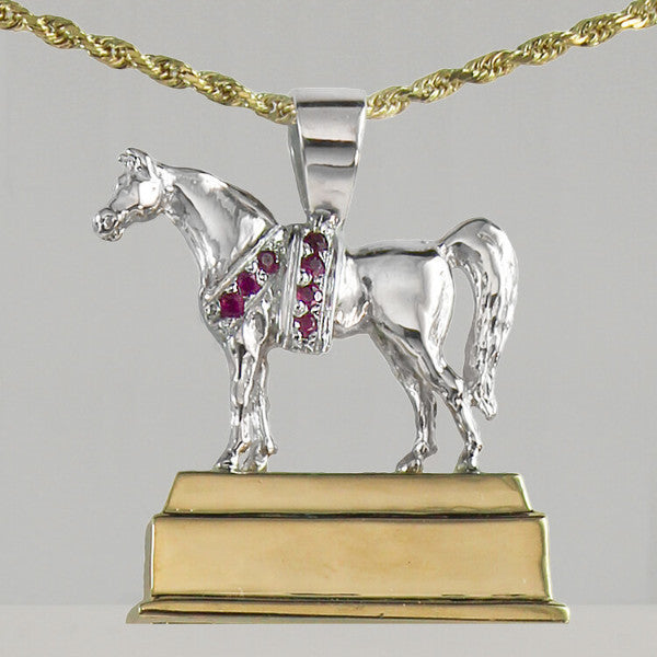 National Champion Arabian Horse Trophy Pendant. Yellow gold base white gold horse with ruby blanket and garland. size small (front view)