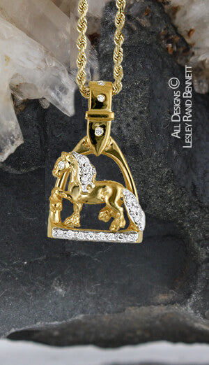 gold trotting friesian in stirrup pendant with diamonds . this copyright design is handcrafted by Lesley Rand Bennett