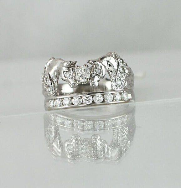 Two Horse Ring with diamond manes eyes and a row of diamonds beneath. 1/2 carat center stone total diamond weight is 1.10c.t.w. by Lesley Rand Bennett