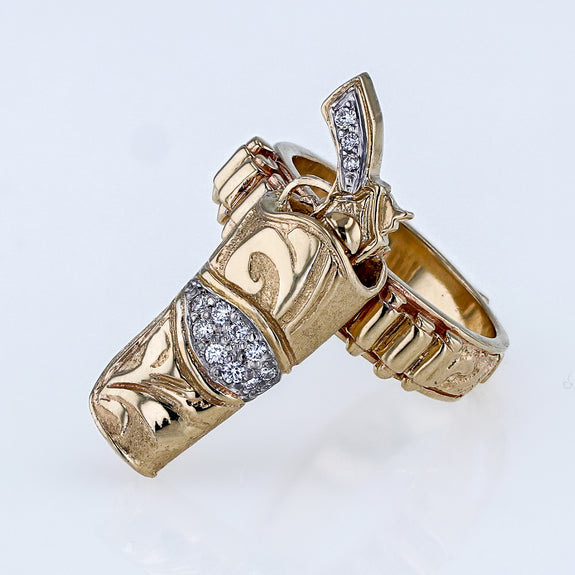 14k yellow gold sharp shooter pistol ring in gold holster with diamonds by Lesley Rand Bennett  Edit alt text
